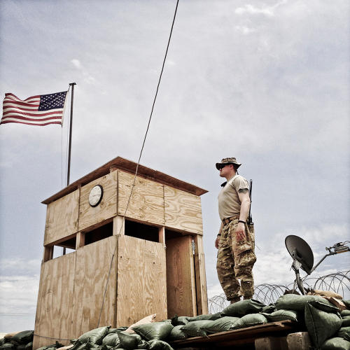 <p>Army adviser Sgt. First Class Mountain Robicheau on top of a bunker in the advisers' compound on FOB Shank.</p>