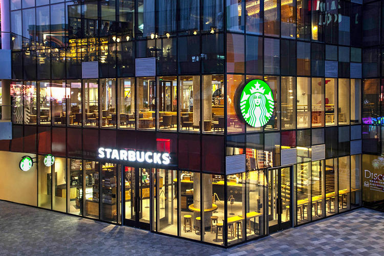 <p>The exterior of Starbucks Taikoo Li Sanlitun, a 24-hour store geared toward the young adults who the one-child policy left relatively companionless.</p>