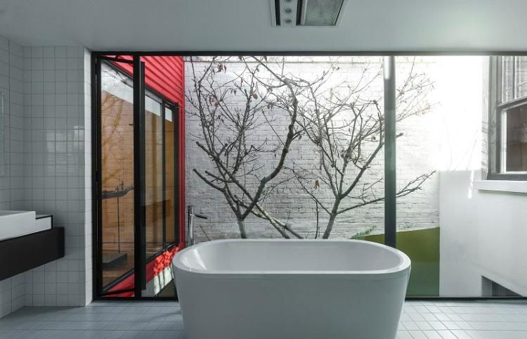 <p>Floor to ceiling windows allow for ample natural light, even while you're taking a bath.</p>