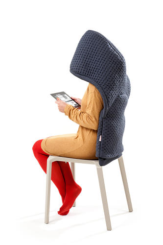 <p>Chair Wear includes four looks: Pique-Pocket, Knit-Net, Hoodini, and Big Baggy. Hoodini, seen here, gives the sitter some seclusion from the outside world.</p>