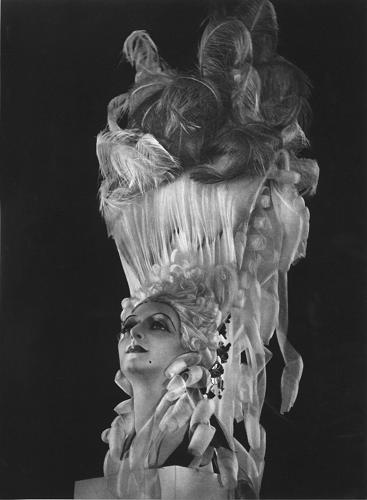 <p>A wig by Antoine de Paris. In 1903, at the age of 17, he arrived in Paris and created &quot;haute coiffure,&quot; raising a craft to an art, and developed a lacquer made with gum arabic for making incredible sculptural wigs.</p>