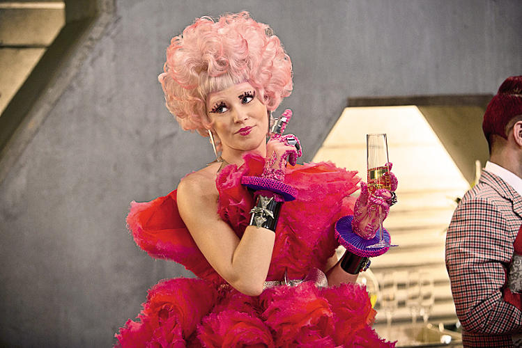 <p><em>Catching Fire</em> - &quot;Effie has this lavish lifestyle in the Capitol, but she's grown close to Peeta and Katniss. So even though she looks put together [the dress is by Alexander McQueen], she's teetering on shoes that are a bit too high, or her waist is cinched in a bit too tight. She's not letting herself ever be fully comfortable. It's kind of her own penance.&quot;</p>