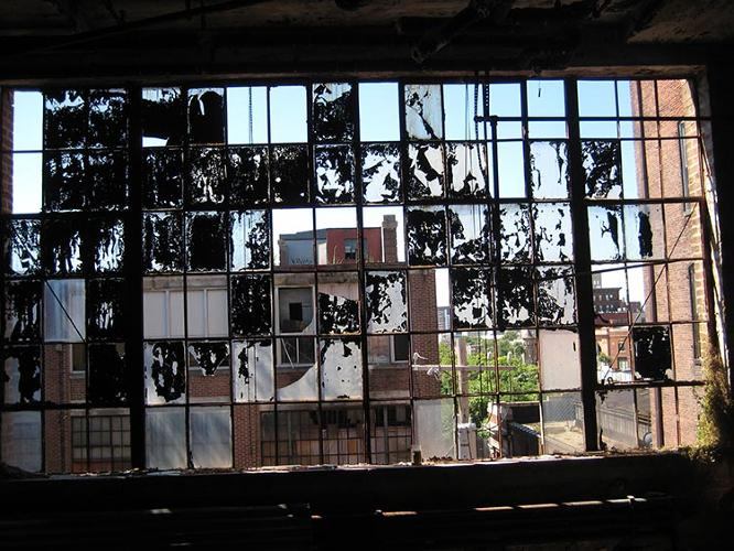 <p>Vandals, graffiti artists, and others would sneak inside to see the ghost-like remnants from the former clothing factory: Sewing machines, coffee cups, mountains of buttons, suits, all left behind when the doors shuttered in the 1980s.</p>