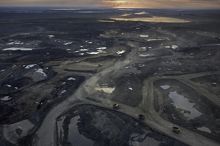 <p>An oil-sands mine operated by Suncor strips the boreal forest growing in the top soil in order to get to the bitumen layer below. Four tons of soil is moved for each barrel of oil recovered.</p>