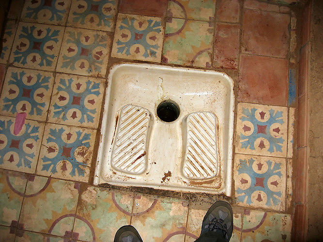 <p>It doesn't get much classier than a squat toilet that practically blends in with the surrounding tile. Located in the desert of Morocco.</p>