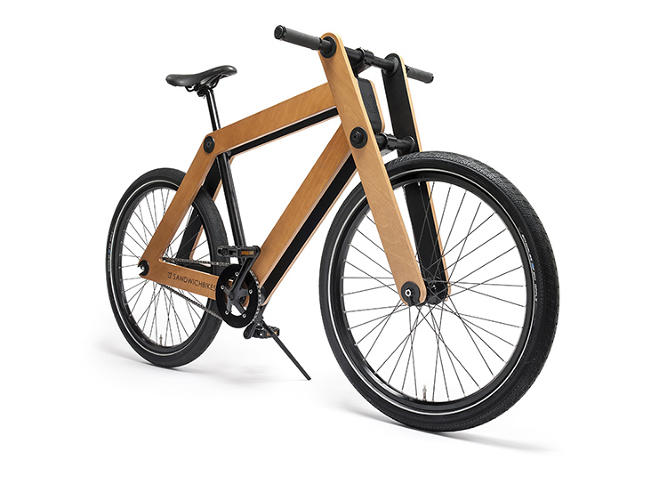 <p>The wheels of the Sandwichbike are, yes, sandwiched between two plywood panels.</p>