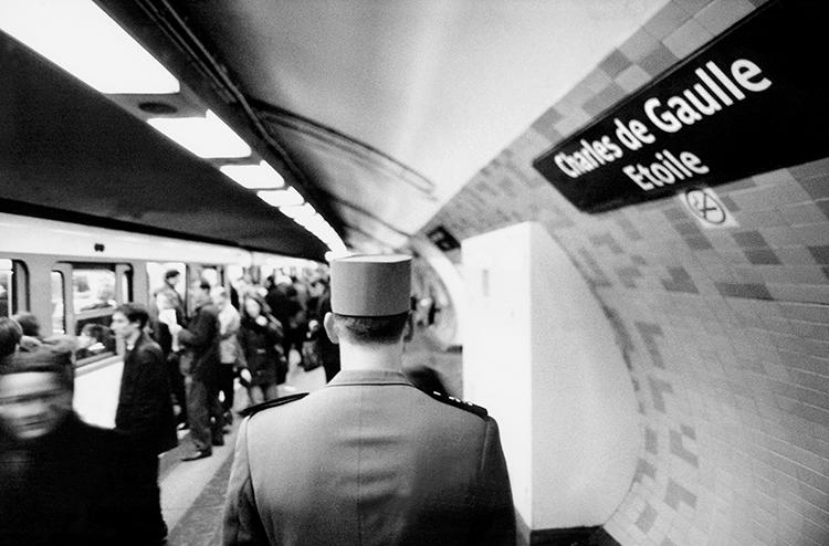 <p>Charles de Gaulle walks a Métro platform named after him.</p>