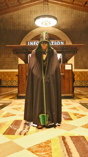 <p>A shrouded figure heralds the final moments in the grand lobby, before the audience moved to the last location for the finale.</p>
