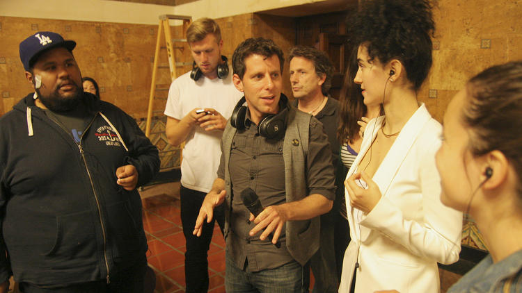 <p>Director Yuval Sharon confers with his singers.</p>