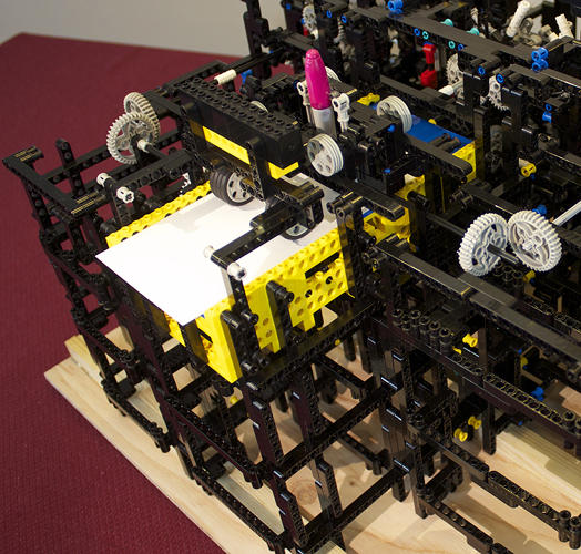 <p>Lego enthusiast Andrew Carol's latest opus: a dizzyingly complicated Lego automaton that can write and draw at the turn of a crank.</p>