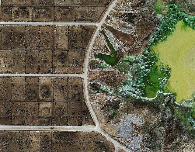 <p>These aerial images of industrial beef farming operations <a href=&quot;http://fastcoexist.com/3016003/these-horrifying-photos-show-a-destroyed-american-landscape-that-agriculture-giants-dont-wan&quot; target=&quot;_self&quot;>look less like shots of land and more like a post-apocalyptic nightmare.</a></p>