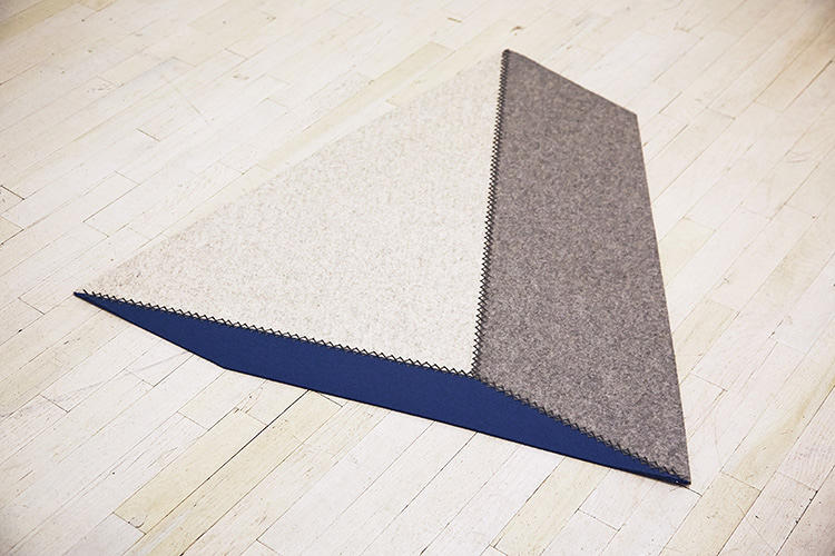 <p>This Wedge Rug, by Brad Ascalon, looks different depending on your viewing angle. ($290 to $550)</p>
