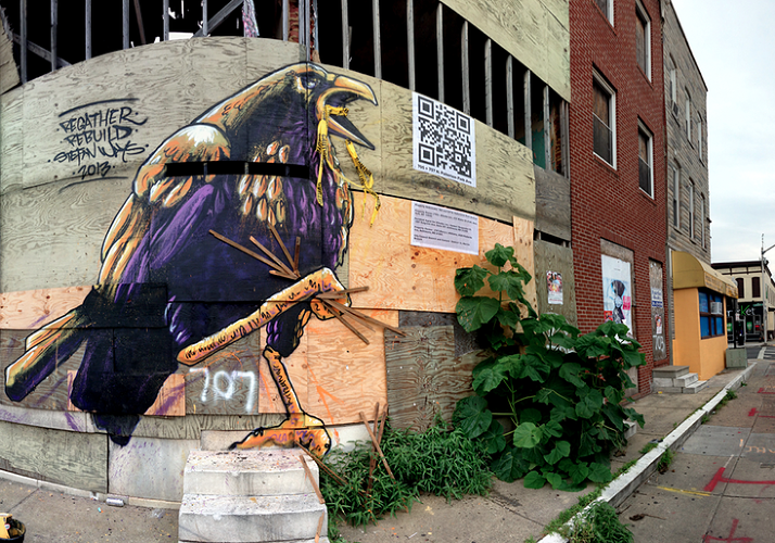 <p>QR codes were included next to each of the murals that linked to Slumlord Watch posts detailing the property owner's actual name and address.</p>