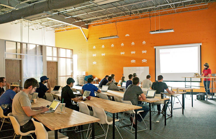 <p>Mason Stewart, CTO and lead instructor, walks a new class through the foundations of programming.</p>