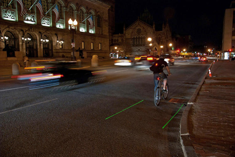 <p>LightLane, a device that clips underneath your bike seat, projects your own personal bike lane as you ride.</p>