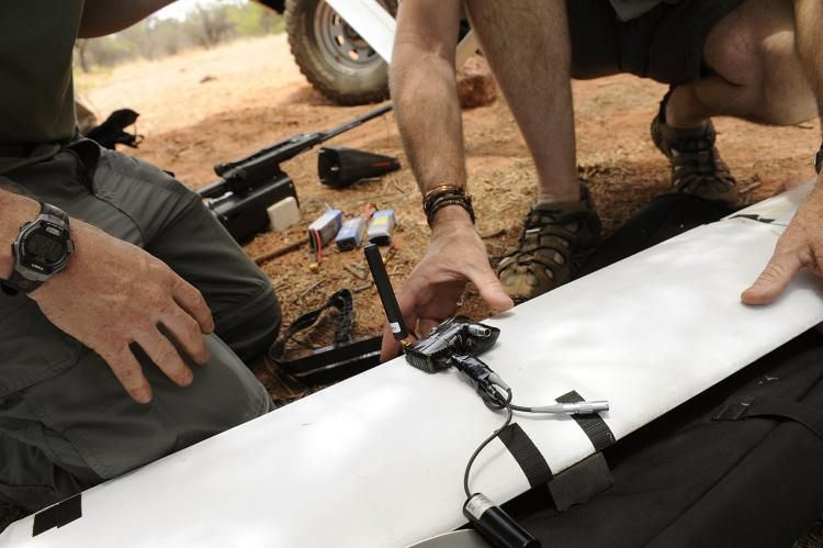 <p>Namibian Ministry of Environment &amp; Tourism employees setting up a system of ground-based sensors connected by a Radio Frequency Mesh Network for rangers to communicate with each other and get pings from RFID-tagged animals.</p>