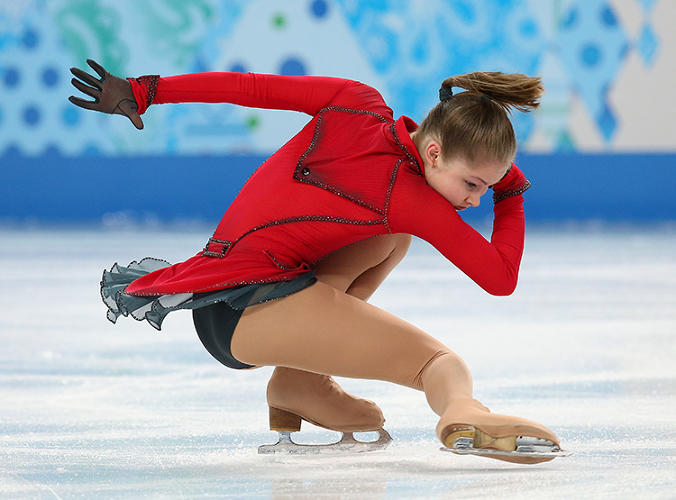 <p>Julia Lipnitskaia of Russia, skating to the theme of <em>Schindler's List, </em>in a red dress inspired by the film's iconic character, &quot;the girl in the red coat.&quot; &quot;This costume is really beautiful,&quot; Yee says. &quot;I've never seen a style like this on the ice. From the grey and red color combination, to the collar detail and gloves, it's a very unique piece.&quot;</p>