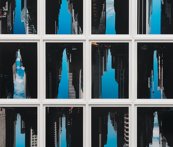 <p>He flips around photos that he's taken standing in the middle of New York City streets to reveal ephemeral skyscrapers made from the space formed between all of the tall buildings</p>