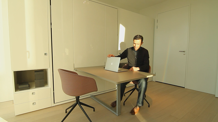 <p>The other room serves as a workspace.</p>