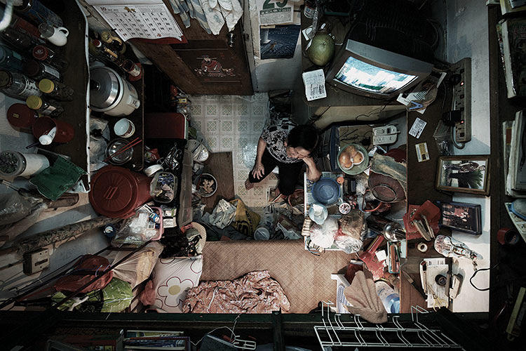 <p>Residents in this series are people living on the fringes of Hong Kong society--low-skilled workers, the unemployed, and elderly people living on their own.</p>