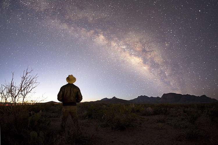 <p>Chisos Mountains, Big Bend National Park. Tyler Nordgren standing under the Milky Way at dawn.</p>