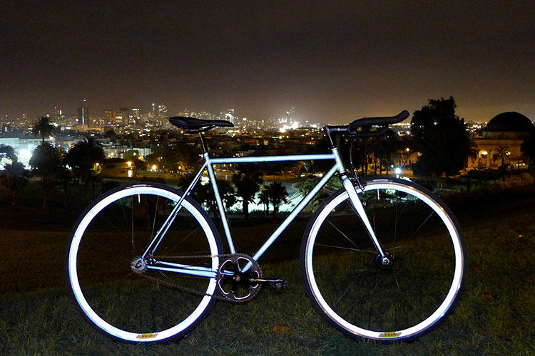 <p>The result is a bicycle that is dark charcoal, almost black, during the day . . . but at night, looks as white as the moon when hit by ambient light, at a distance of up to 1,000 feet.</p>