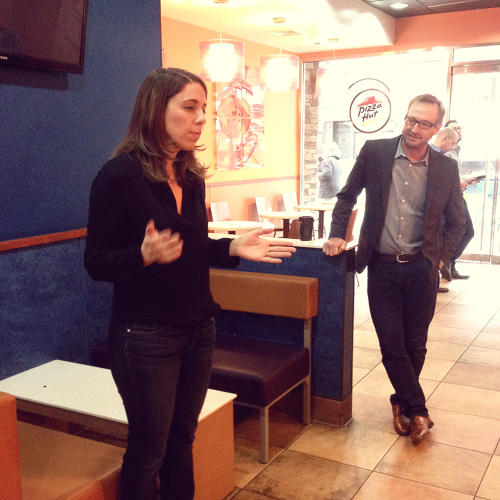 <p>Taco Bell brand marketing director Stephanie Purdue talks to attendees at a preview event.</p>