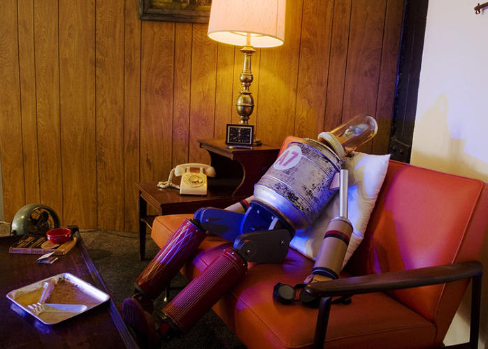 <p>Fraley's domestic scenes, with interior design inspired by 1950s suburban homes, offer a humanizing look at the mundane, wholesome lives of these artificial metal beings.</p>