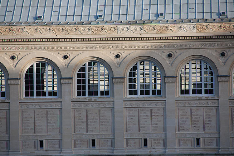 <p>Designed by Henri Labrouste, 1851, the Sainte-Genevieve Library inherited the prized collections of the sixth-century Abbey de Sainte-Geneviève. The two-story façade bears the names of 810 great figures.</p>
