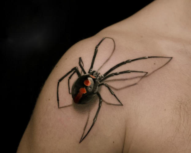 <p>Not a real spider, thankfully: It's only a 3-D-ish tattoo.</p>