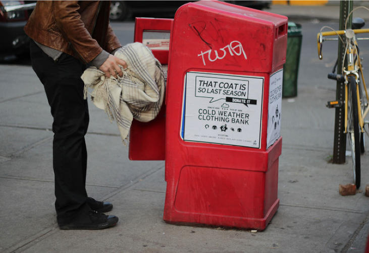 <p>A newspaper rack turned into a &quot;cold weather clothing bank&quot; with the<br /> addition of a sign.</p>