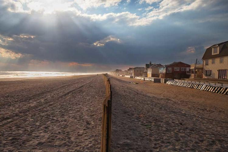 <p>In the wake of Hurricane Sandy, many beach side communities in New York City, like this one in Belle Harbor, Queens, have little more than a fence and a line of sandbags between themselves and the rising seas.</p>
