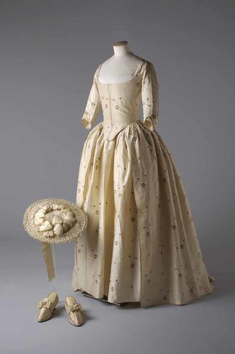 <p>Dating from 1780, this flower-printed silk brocade gown and petticoat with a straw hat was a classic example of the conservative church wedding fashions of the time.</p>