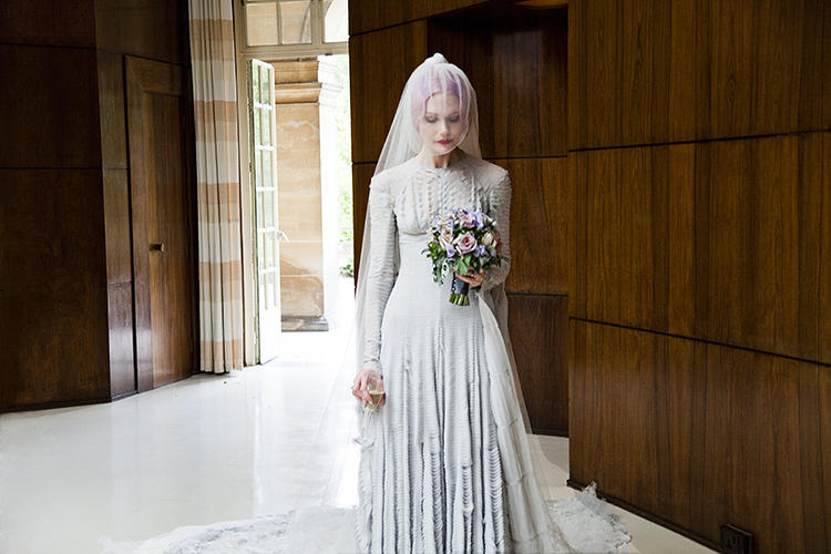 <p>Pale grey slashed chiffon wedding dress designed by Gareth Pugh and veil by Stephen Jones, 2011, worn by Katie Shillingford for her marriage to Alex Dromgoole.</p>