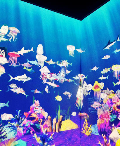 <p>Visitors can color their own fish and watch them pop up in the interactive aquarium at the Tokyo Design exhibit.</p>