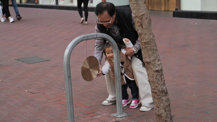 <p>Up first: A gong hanging under a U-shaped bike rack that acts as an impromptu musical instrument.</p>