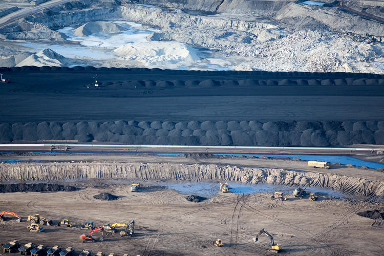 <p>Piles of uncovered petrolum coke, a byproduct of upgrading tar sands oil to synthetic crude.</p>
