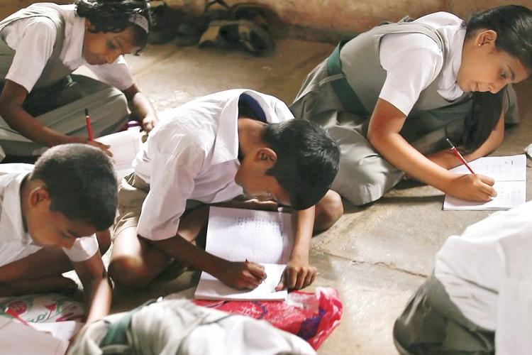 <p>This foldable design turns into a desk and a book bag for poor school children in India.</p>