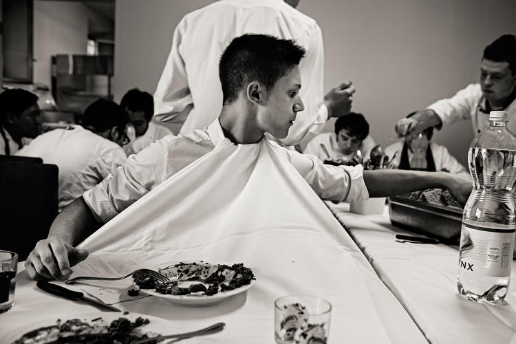 <p>A waiter keeps his shirt clean during a meal at Osteria Francescana</p>
