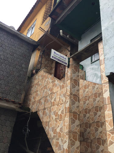 <p>The entrepreneur also greets tourists when they arrive at the bottom of the favela (like many of the city's favelas, Rocinha is built into a hillside) and helps them get to their final destination.</p>