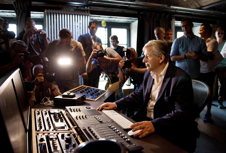 <p>Governing Mayor of Berlin, Klaus Wowereit, sits at the opening of the startup center &quot;Factory Berlin&quot; on 6/11/2014 in Berlin on a mixing board in a recording studio in the premises of SoundCloud.</p>