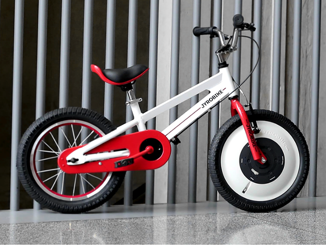 <p>The secret is a quickly-spinning disc inside the front wheel, which uses gyroscopic force to automatically balance the small bike whenever it starts to wobble.</p>