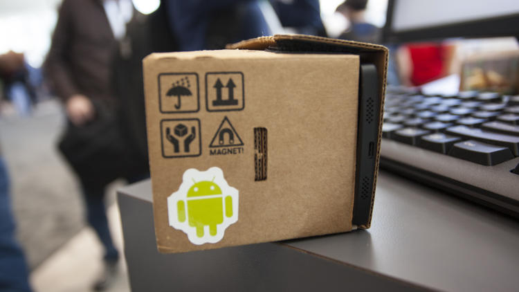 <p>The smartphone is tucked into one end of the cardboard VR headset.</p>