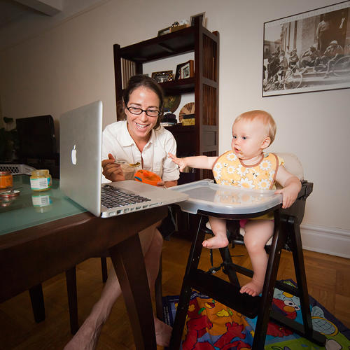 <p>On New York's Upper West Side, a mother feeds her nine-month-old daughter as they share a meal with the baby's grandparents--in Boston--over Skype.</p>