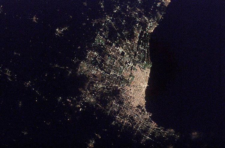 <p>Since 2003, when an astronaut figured out how to snap a clear photo of the view from orbit, hundreds of thousands of amazing urban photographs have piled up in archives.</p>