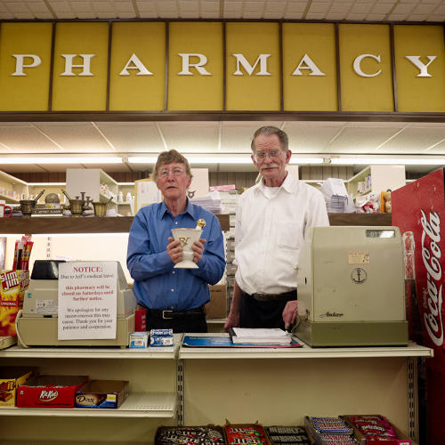 <p>Peoples Pharmacy, Superior, established circa 1933 by John Olsen. Both owner Jeff Eliason (left) and employee Art Haugen are pharmacists.</p>