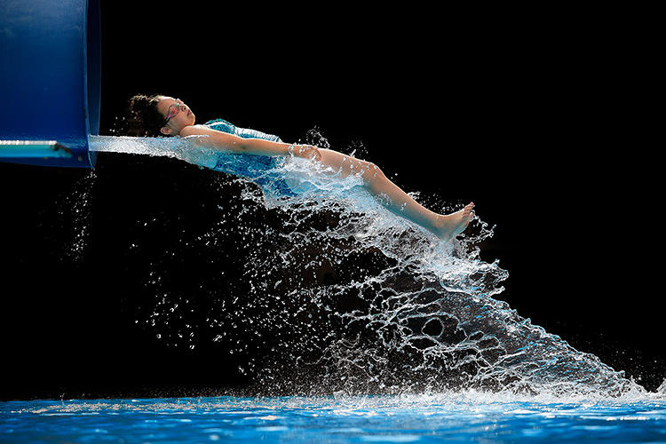 <p>In her &quot;I Love Summer&quot; series, Long used a high-speed camera to capture swimmers as they shot out of the end of a water slide.</p>