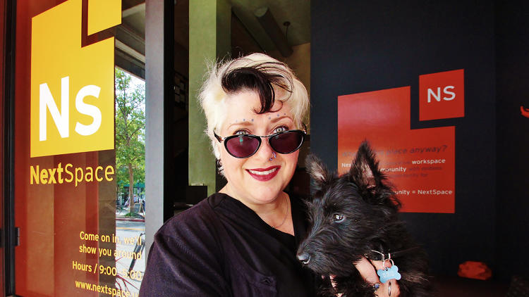 <p>Lise Quinatana, seen here with her dog Dalziel, is the founder of the tech startup Narrative Technologies.</p>