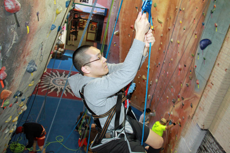 <p>Victor Tu ascends climbing wall at Prime Club in Wallingford CT</p>