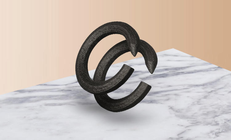 <p>Resembling a nail that has been hammered into the shape of a ring, it's meant to mark the bond of creative mediocrity forged between two mid-level creatives within the belly of a modern marketing firm.</p>